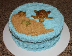 Buttercream frosted with gumpaste/fondant sea turtles.
