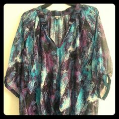 Sheer/Multi-colored top Black, turquoise, and purple...with silver accents throughout the top. V-neck ...very comfortable. Half length sleeves... Tops Blouses