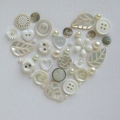 Cute idea... Use old buttons to create a heart shape like this, top it off with a shadow box frame to finish the look, and you have homemade art! This would be cute in a star with colored buttons.