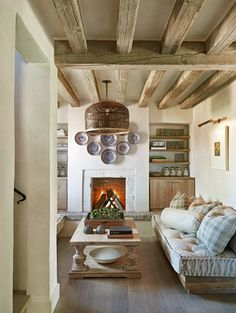 This rustic-style living room is simple yet beautiful, with pale wood trim, beams, and furnishings. Note:  much to love.  (via Don Ziebell)