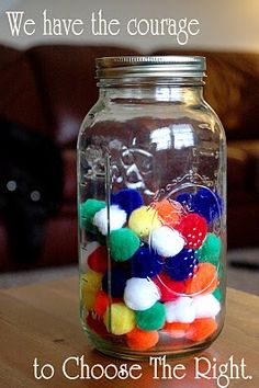 The courage jar. Every time someone does something courageous, they get to pick how many puff balls they get to put into the jar. When the jar reaches 150 fuzzies, do something fun to celebrate.