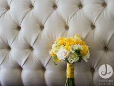 Jazmine wanted vibrant gold for her Indian-American wedding at The Sonnet House this June. Her bouquet was a lush, mounded bouquet of yellow and cream with a beautiful paisley wrap.   Florals by The Sonnet House Photography by Jennifer Lee Portraits