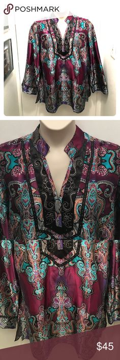 Lane Bryant Boho Tunic Like new. This is one gorgeous piece! Pics don't do it justice. Multicolored design, black sequins and silver stitching around collar and sleeves. Absolutely beautiful. Size 18/20, true to size. Lane Bryant Tops Tunics