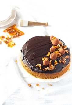 This chocolate carrot cake combines the perfect winter warming flavors of spices and carrots topped with a decadent and glossy chocolate ganache and decorated with golden walnut praline. Click to get the recipe.