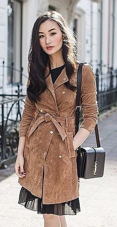 A suede coat over a delicate dress; the designer bag is the prefect finishing touch.