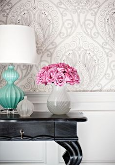 a large print wallpaper does not have to overwhelming.  use a tonal print to add subtle interest to a small room (bath) or a single wall in a larger room (dining)