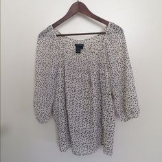 Black & White Heart Print Blouse Sweet white top with black heart print. 3/4 sleeves that are fitted at the bottom. Fits loose, has a sort of ruffle detail on the front. Last pic shows the detailing. 100% polyester. Perfect condition. Max Edition Tops Blouses
