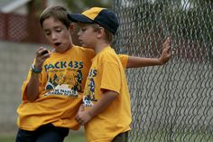 Justin Marroquin, left, checks out a pedometer with fellow Cub Scout Ethan Klauss after a foot race in Costa Mesa. It took three years of applied behavior analysis for Justin to beat autism, his mother says. (Francine Orr / Los Angeles Times)