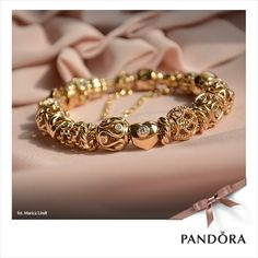 Gold Pandora bracelet with gold charms