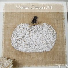 Gather the kid's crayons and melt them down to create a wall hanging for fall