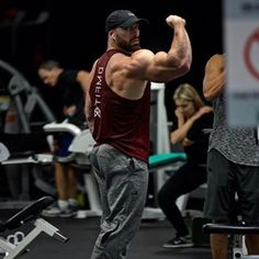 "Clothing line started by the legendary Bradley Martyn, with famous products such as BMFIT hats & ""Everyday Is Arm Day"" t-shirts & tanks, BMFIT apparel is s Bradley Martyn, Gym Outfit Men, Arm Day, Gym Style, Muscle Men, Bearded Men, Mens Fitness, Gymnastics, Bodybuilding"