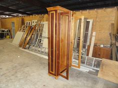 Bookcase - built out of 100+ yr old reclaimed cypress.  Beveled glass and glass shelves not installed yet.