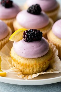 These lemon cupcakes are soft, fluffy, and exploding with lemon flavor! Topped with fresh blackberry cream cheese frosting!