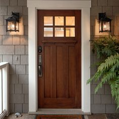 Oak Exterior Front Door with gray house and white trim, lighting hardware black