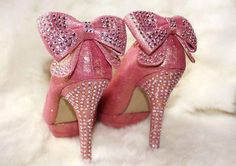 these shoes are SOO you, Barbie. Sparkly, glittery, and they are pink, ad have bows