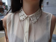 Studded collar.