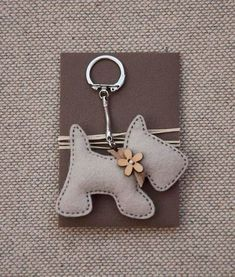 Items similar to Little Dog with a Wooden Flower Button - Keychain Pendant on Etsy crafts crafts crafts decoracion crafts Felt Crafts, Fabric Crafts, Sewing Crafts, Sewing Projects, Felt Keyring, Felt Dogs, Wooden Flowers, Felt Decorations, Little Puppies