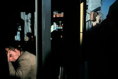 Magnum Photos -  Alex Webb // TURKEY. Istanbul. 2003. Barbershop with blown-out windows below the bombed British consulate.
