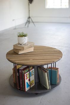 round wooden slat top coffee table with metal spindles  $249.00