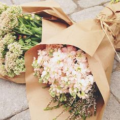 I want to buy flowers where they are wrapped in brown craft paper.