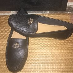 NWOB COACH Loafers 8B NWOB COACH soft black patent leather loafers in size 8B. Gold logo. Never worn; perfect condition. Retail: $128. Coach Shoes Flats & Loafers