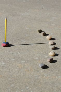 Making a sundial for our backyard.  Maybe heavier rocks? or cement it when done?