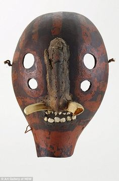 Another mask from the Chuave people, made in the mid 20th century. It is made from a variety of natural materials including pig tusks and the teeth from an unidentified mammal