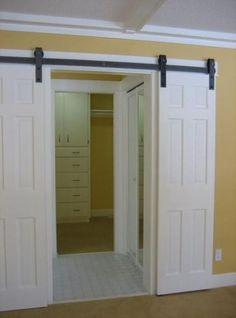 DIY barn door can be your best option when considering cheap materials for setting up a sliding barn door. DIY barn door requires a DIY barn door hardware and a Double Closet Doors, Double Barn Doors, Wooden Barn Doors, Diy Barn Door, Metal Barn, Interior Sliding Barn Doors, Sliding Barn Door Hardware, Sliding Doors, Door Hinges
