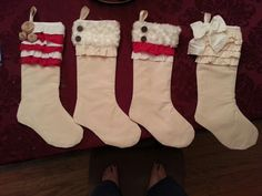 Homemade stockings. Love the ruffles. Might add to the girls.