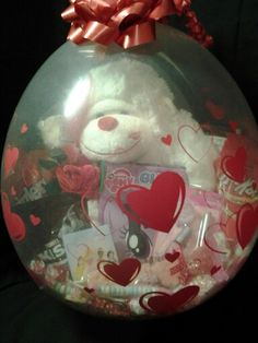 Created by Niftygiftsbystacy. ...Heart all around stuffed gift balloon