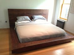 This custom platform bed is made from a salvaged 400-year-old Heart Pine beam. Only the surface boards of the beams were used so that the original saw marks could still be seen. The wood was reclaimed from the demolished Philipp Morris building in Louisville, KY - a structure of incredible architectural history. It has found a new home in a Harlem Townhouse uptown in New York City.