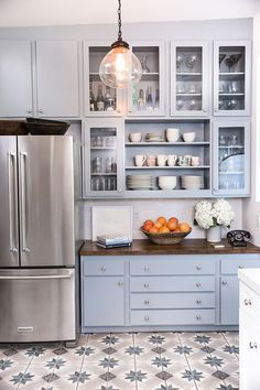 In Jamie Chung's vintage-inspired kitchen makeover, her tired kitchen is brightened by fresh paint, appliances, and lighting to better reflect her style. Check out this charming, budget-friendly transformation from Design with Lowe's powered by Decorist.