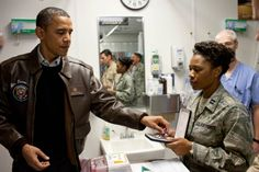 Reaching for a PURPLE HEART MEDAL to present to a wounded soldier at Bagram Air Field in Afghanistan,.12/3/2010.