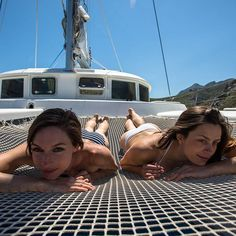 Ralax on catamaran ' s net. Models : @harmonycalhoun and @lenadrapella Photo : @paolosartophoto #sail #sailing #swim #tanning #enjoylife #travel #travelgram #bestvacations #vacationidea #relax #enjoy #zara #swimsuit #vacation #earthgirllifestyle #liveoutdoors #welivetoexplore #travelstoke #travelawesome #travelmore #getoutside #water #fit #fitness #instatravel #waves #relaxation # #