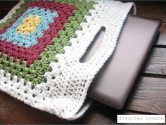"I MADE THIS LAPTOP BAG USING THE GRANNY SQUARE TOTE PATTERN FROM MY BOOK ""CROCHET CHIC"". INSTEAD OF USING THE CURVED WOODEN HANDLES THAT..."