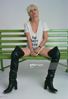 Premium Rates Apply. Singer Debbie Harry, of American pop group Blondie, poses in a Patti Smith T-shirt and thigh-length boots, June 1977.