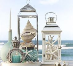 Metal Lantern Seaside - Seashells and starfish in empty lanterns or candle holders for beachy flair
