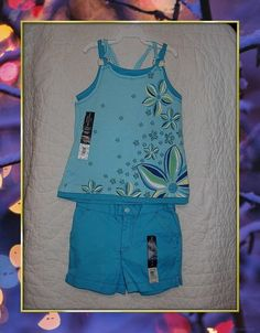 Mouse over image to zoom                                                                                                                                                                                                                               Have one to sell? Sell it yourself         New Faded Glory Spring Girls Blue Shorts & Tank Top 2 pc Set 4 to 5 NWT Summer   Ebay item # 160976549126