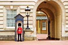 A Queen's Guard outside Buckingham Palace. Credit: Corbis
