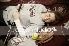 Senior portrait with softball player laying with her gear