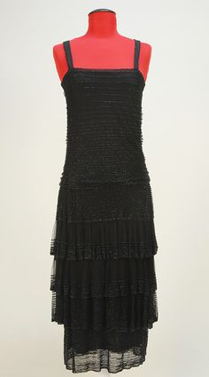 """Chanel 1920s. Early dress with early """"Gabrielle Chanel"""" label. From an auction at the Charles A. Whitaker Gallery, April 27-28, 2012."""