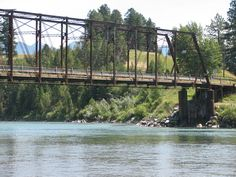 THE OLD STEEL BRIDGE OVER THE FLATHEAD RIVER WAS 100+ YEARS OLD BEFORE IT WAS FINALLY REBUILT.