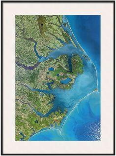 Show pride for your favorite place with this Art.com Outer Banks, North Carolina from Space framed wall art. <ul> <li>Contemporary style PRODUCT DETAILS</li> <li>36''H x 26''W x 1''D</li> <li>Paper, acrylic, wood</li> <li>Vertical display</li> <li>Attached hanging wire</li> <li>Wipe clean</li> <li>Model no. 9950524</li> </ul>