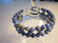 Sodalite bracelet with two-strand slide tube clasp