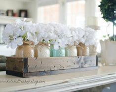 Rustic Planter Box with Painted Mason Jars. Centerpiece. Tropical Green. Cream. Tan Mason Jars. Dinning Table. Painted Mason Jars. Rustic.