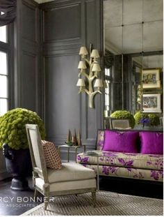 Wood paneled living room, purple pillows. Traditional home decor.