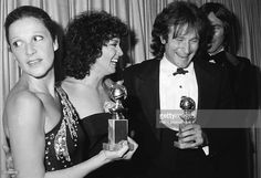 Backstage at the Golden Globes Awards, American actress Linda Lavin (left) holds an award trophy and looks to her right at as actress Joyce Dewitt congratulates comedian and actor Robin Williams, also a winner, at the Beverly Hilton, Beverly Hills, California, January 27, 1979. Actor Richard Hatch is partly obscured behind Williams.