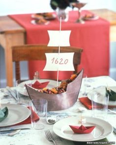 A miniature Mayflower sets sail on a map tablecloth, while paper-boat place cards guide young guests to their seats.