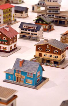 """...building models made by Peter Fritz in the 1950s an 1960s. Not much is known about the author, an Austrian insurance clerk who carefully constructed and depicted the cardboard pieces. The models were not made out of existing architectures but rather were inventions of the author who probably recombined details of buildings he must have crossed in his hometown."""