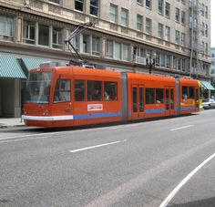 Portland Streetcars run an 8 mile loop connecting the inner city neighborhoods with the city center.